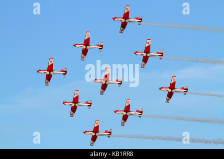 The Swiss Air Force PC-7 aerobatic display team flying in diamond formation during an airshow performance - Stock Photo