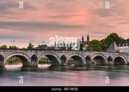 Sint Servaasbrug (or the St. Servatius Bridge) is an arched stone footbridge across the Meuse River in Maastricht, - Stock Photo