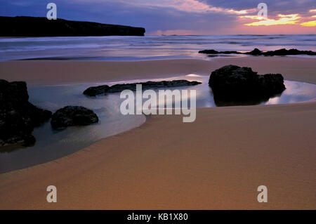 Portugal, Algarve, romantic evening mood on the beach Praia da Amoreira in the nature reserve Costa Vicentina,