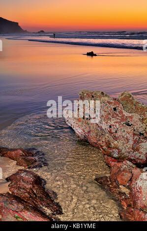 Portugal, Algarve, evening rock beach Praia do Amado in the nature reserve Costa Vicentina,