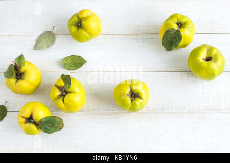 healthy lifestyle, nutrition, treatment concept. top view of lemon yellow fruits picked up from quince tree, they - Stock Photo