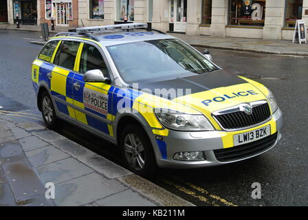 City of London Police marked car parked next to a pavement, London, England, UK - Stock Photo