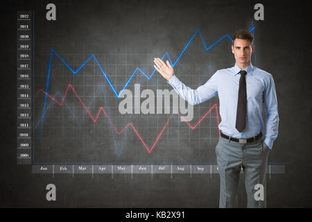 businessman with virtual finance graphic in background - Stock Photo