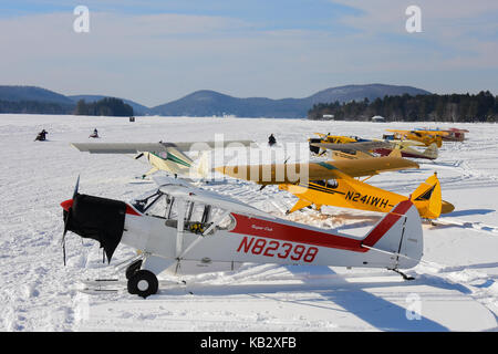 Yellow red airplane at the mountain ski resort airfield in for Red lake ice fishing resorts
