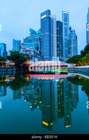 Singapore downtown financial business district skyline at dawn with brightly lit Anderson Bridge in the middle and - Stock Photo