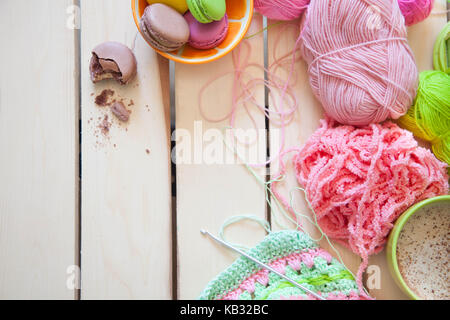 Balls of colored yarn. View from above. All the colors of the rainbow. Sample knit. - Stock Photo