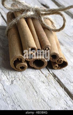 Cinnamon on wooden planks, - Stock Photo