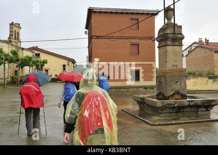 Spain, Way of St. James, pilgrim's group in streaming rain on the Camino in Castildelgado, - Stock Photo