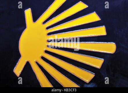 Spain, Way of St. James, yellow scallop shell on blue ground, icon of the Way of St. James, - Stock Photo