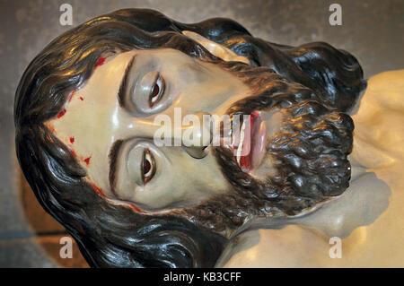 Spain, Kastilien-Leon, dead person Jesus on the lap of Maria in the crucifixion chapel of the Basilica de la Encina - Stock Photo