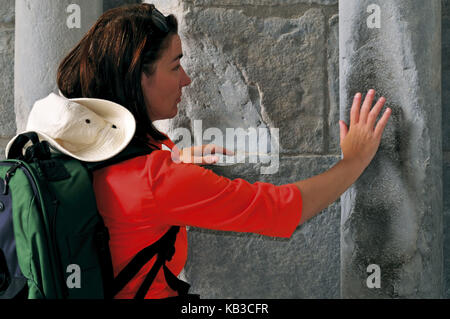 Spain, Way of St. James, ritual touch of the Romanesque portal of the cathedral of Jaca, - Stock Photo