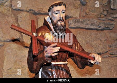 Spain, Galicia, statue of the saint Franziskus as a pilgrim in the parish church Santa Maria la Real in O Cebreiro, - Stock Photo