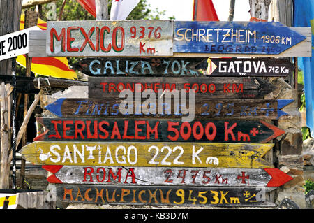 Spain, Way of St. James, jungle of road signs in front of the pilgrim's hostel of Manjarin,