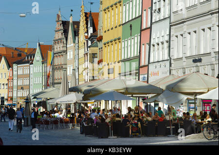 Landshut in Lower Bavaria, historical house line in the city centre with street cafe, - Stock Photo
