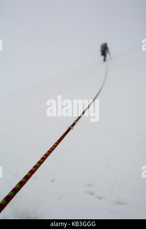 Woman, alpine tour in the fog, High Tauern (Hohe Tauern), Austria, - Stock Photo