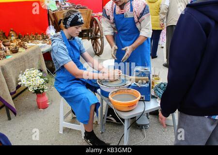 June, 2017, Odoev (Russia): Folk Festival 'Grandfather Filimon's Tales' - master class on making pottery. - Stock Photo