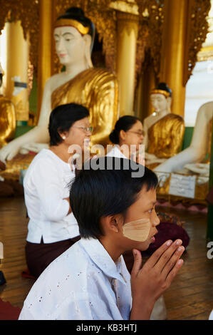 People in the Shwedagon Paya pagoda, Myanmar, Asia, - Stock Photo