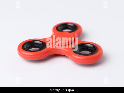 Red fidget spinner cut out isolated on white background - Stock Photo