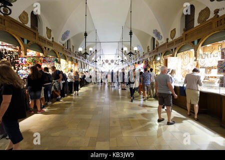 Sukiennice aka The Cloth Hall or Drapers' Hall in the main Market Square of Krakow, Poland, Europe - Stock Photo