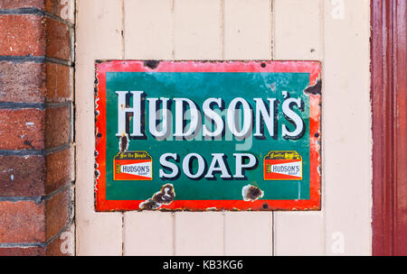 Vintage enamel Hudson's Soap sign at East Sussex Railway heritage steam railway, Tenderden Town Station, Kent, south - Stock Photo