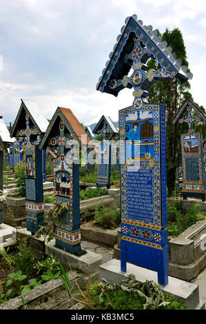Romania, Maramures Region, Carpathian Mountains area, near Sighetu Marmatiei, Sapanta colourful cemetery - Stock Photo
