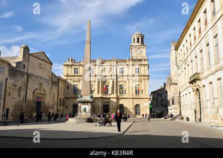 France, Bouches du Rhone, Arles, Place de la Republique, the clock tower of the city hall, the fountain obelisk - Stock Photo