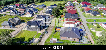 Aerial photo with the drone, anew build-up plot with single houses and gardens, narrow neighborhood - Stock Photo