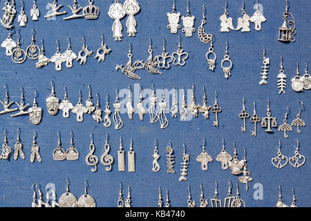 Lviv, Ukraine - July 16, 2015: Earrings of different shapes for sale on a market in Lviv, Ukraine. - Stock Photo