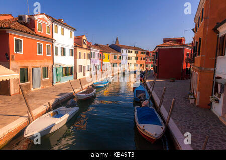 Canal scene in the colorful Italian island of Burano, located just off Venice, Italy - Stock Photo