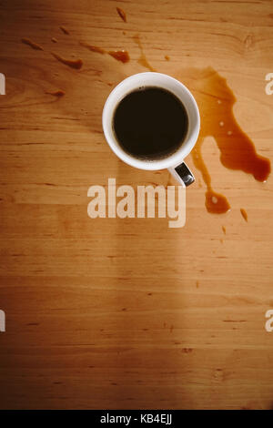 Coffee spilled on a table - Stock Photo