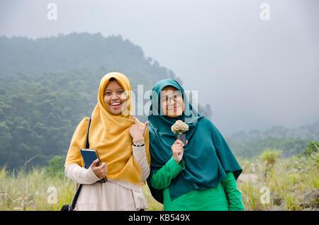 Muslim girls in Java, Indonesia - Stock Photo