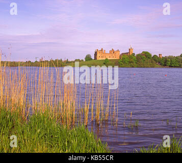 Summer view across Linlithgow Loch towards Linlithgow Palace, West Lothian - Stock Photo