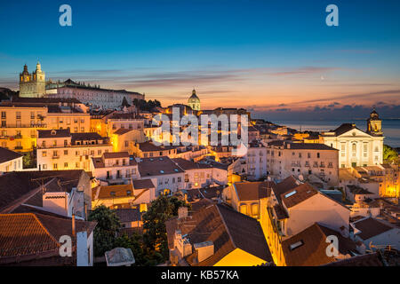 Alfama old town district in Lisbon at night, Portugal - Stock Photo