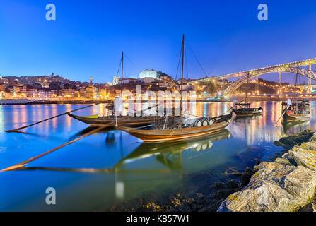 Traditional port wine transport boats in Porto, Portugal - Stock Photo