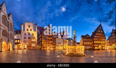 Panorama of the historic market square in the old city of Hildesheim, Germany by night - Stock Photo