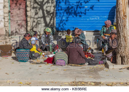 Friends and Family gather outside the Pelkhor Chode Monastery in Tibet - Stock Photo