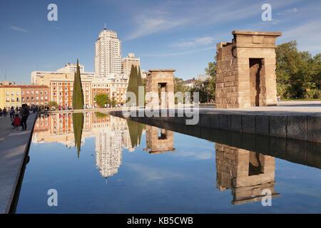 Temple of Debod (Templo de Debod), Parque del Oeste, Edificio Espana tower in the background, Madrid, Spain, Europe - Stock Photo