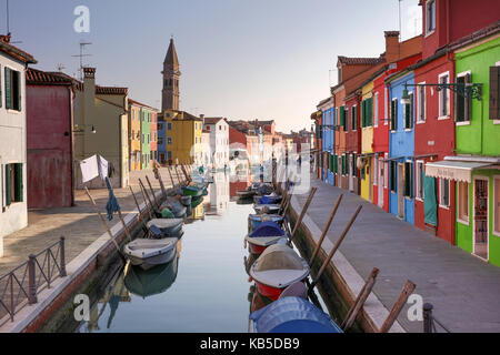 Colourful houses and reflections in canal, Island of Burano, Venice, UNESCO World Heritage Site, Veneto, Italy, - Stock Photo