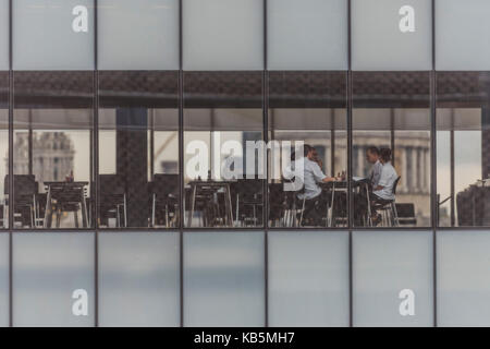 London, UK. 28th Sep, 2017. A staff meeting in the restaurant of the Tate Modern gallery with St Paul's in the background. - Stock Photo