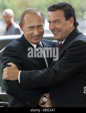 FILE - Former German Chancellor Gerhard Schroeder (r) welcomes the Russian President Vladimir Putin in Berlin, Germany, - Stock Photo