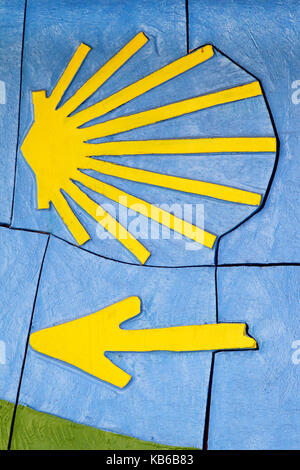Santiago shell in yellow with blue background, Santiago de Compostela, Galicia, Spain - Stock Photo