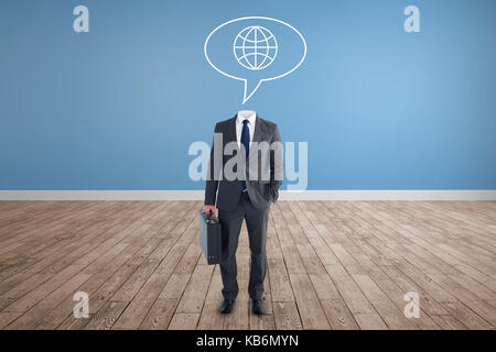 Headless businessman standing with briefcase against room with wooden floor - Stock Photo