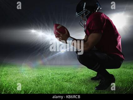 Digital composite of american football  player sitting down in stadium - Stock Photo