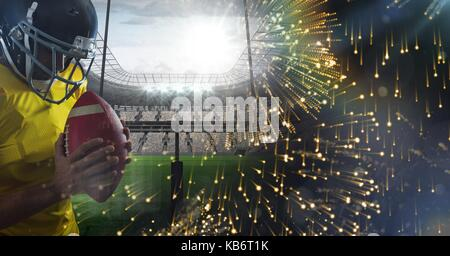 Digital composite of American football player with stadium transition - Stock Photo
