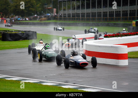 Classic 1960s Grand Prix cars racing in the Glover Trophy at the Goodwood Revival 2017 in the rain. Space for copy - Stock Photo