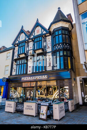 Historic timber framed building, with a Pizza Express restaurant (nobody in shot), in Peterborough city centre, - Stock Photo