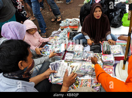 Street vendor sells DVD at used stuff market, Palembang, South Sumatera, Indonesia - Stock Photo