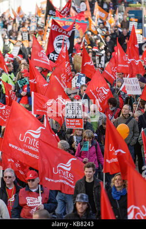 Bristol 30-11-2011- Protesting public sector workers from the Unite union are  shown carrying flags as they take - Stock Photo