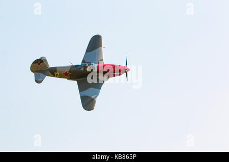 PRAGUE, CZECH REPUBLIC - 9.09.2017: Propeller military plane yak parking at the airport in sunny day, Prague, Czech - Stock Photo