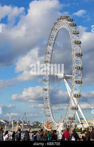 LONDON - SEPTEMBER 2017; People on the westminster bridge with London Eye on the background. - Stock Photo